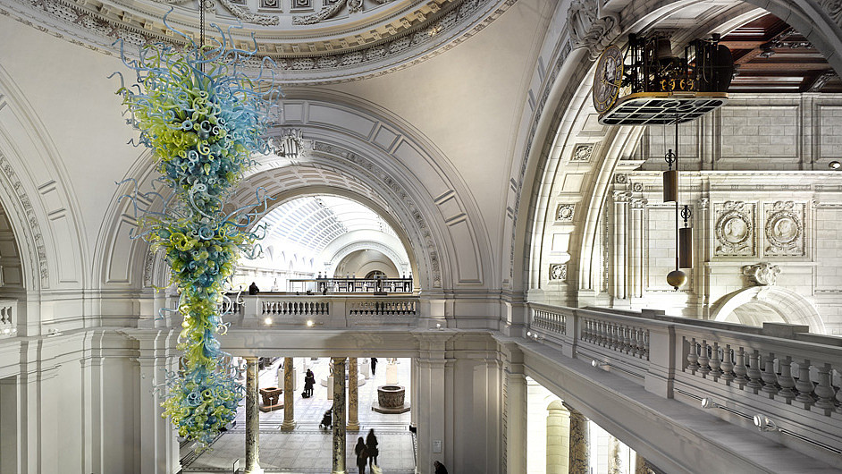 Modern glass art piece hanging from the ceiling of a classic building.  © Victoria and Albert Museum, Image: James Medcraft