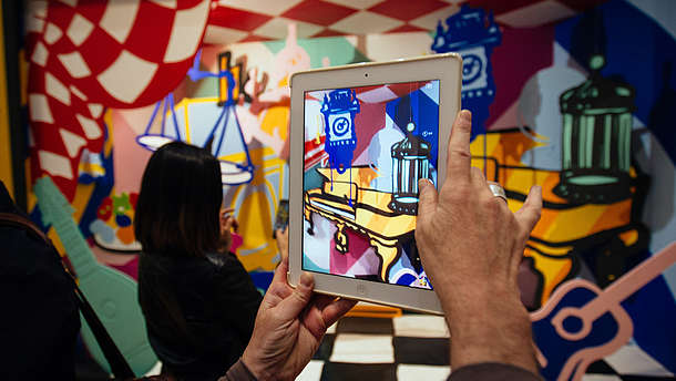 Person takes a photo of a colourful and abstract installation using a tablet  © Image: Courtesy Pimlico Project